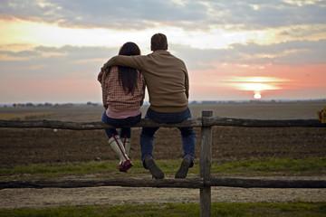 Young Couple Sitting On Wooden Fence, Baranja, Croatia, Europe