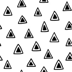 Seamless hand drawn geometric tribal pattern with triangles. Vector navajo design.