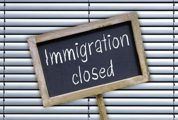Immigration closed - chalkboard with text on closed border
