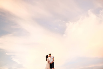 Couple in love kissing on fairy sky background