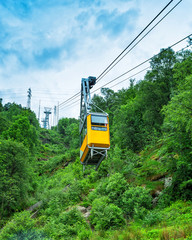 Cableway lift gondola cabins on mountains background beautiful scenery