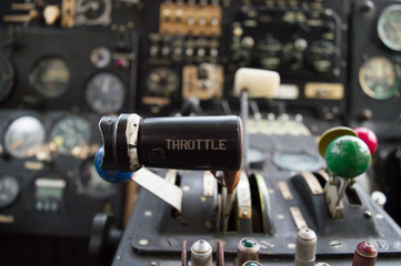 Throttle lever and instruments in a vintage airplane cockpit
