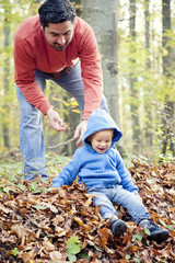 Father playing with son in forest, Osijek, Croatia