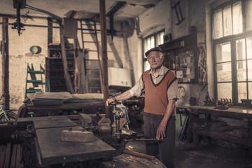 Senior carpenter in his workshop, Karanac, Baranja, Croatia