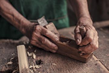 Senior carpenter in his workshop using wood plane, Karanac, Baranja, Croatia