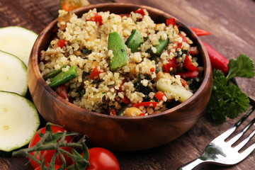 Delicious vegetarian quinoa salad with bell pepper, cucumber and tomatoes