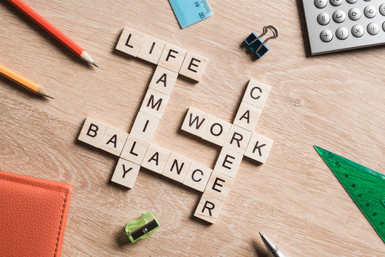 Words work life balance and family on table collected with wooden cubes