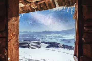 chalets in the mountains at night under the stars. Magic event i