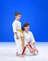 On a blue background mother and son the athletes with a smile on his face