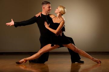 9404477a7 Beautiful ballroom couple preforming their pasonate exhibition dance