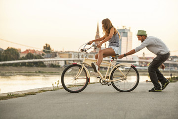 Young couple with bicycle, having fun, Osijek, Croatia