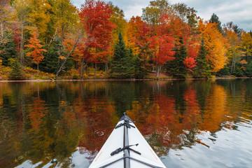 Kayaking in an autumn lake in upstate new york