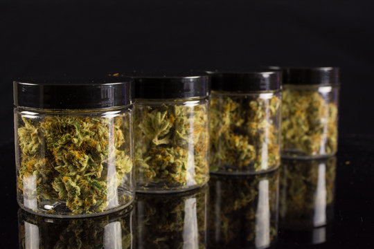 4 staggered quarter ounce jars of marijuana cannabis