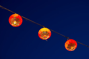 Red Chinese Lanterns for Chinese New Year Against a Blue Night Sky.