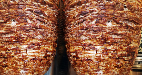 Close up texture of rotating skewered meat grilled