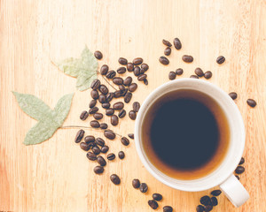 coffee bean and coffee mug on wood background