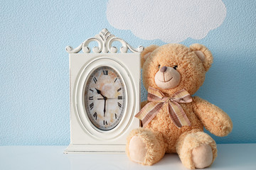 Table clock and teddy bear