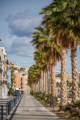 Promenade and beach in colorful village of Villajoyosa in Spain