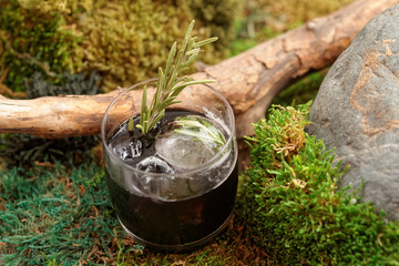 Black cocktail on moss