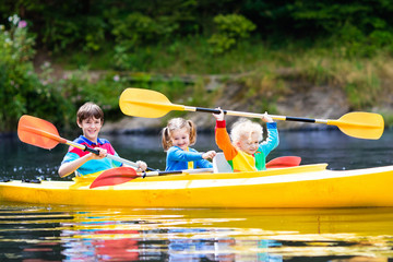 Kids kayaking on a river