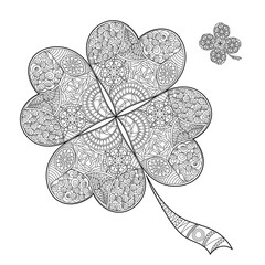 Coloring book shamrock on St. Patrick's Day.Black and white clover with four leaves. Decorated with hand draw doodle pattern. Vector sign of good luck.