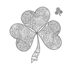 Coloring book shamrock on St. Patrick's Day.Black and white clover with three leaves. Decorated with hand draw doodle pattern. Vector sign of good luck.