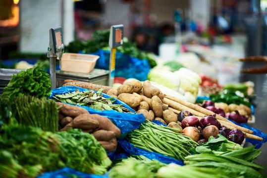 Vegetable market in Shanghai, China. Focus on potatoes.