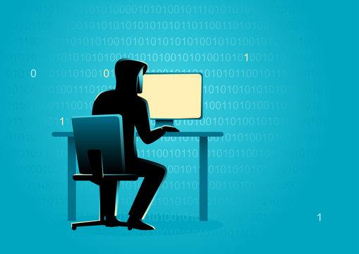 Hacker behind desktop computer