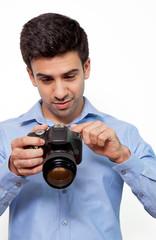 Amazed photographer watching camera screen