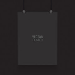 Black vertical poster template hanging on clips, isolated on a black background. Poster realistic mokcup.