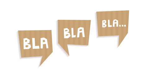 Speech bubbles cut out of carton with words Bla bla bla