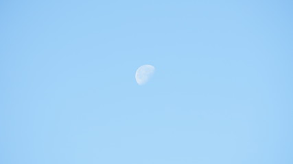 Clear blue sky with a waning gibbous moon
