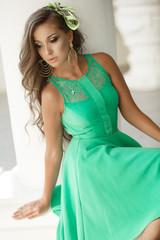 beautiful summer woman in green dress outdoors