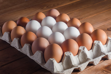 Eggs in a tray on a wooden table
