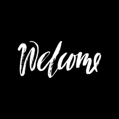 Welcome inscription. Greeting card with calligraphy. Hand drawn design elements. Black and white vector illustration.