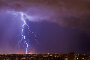 Beautiful lightning above the night city