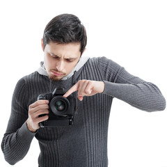 young photographer sets up the camera isolated on white backgrou