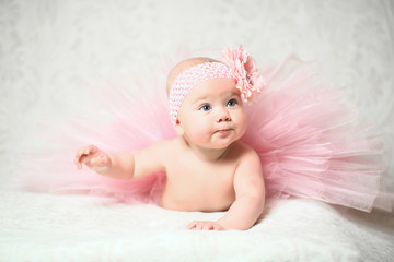 cute little baby girl in a nice pink flared dress