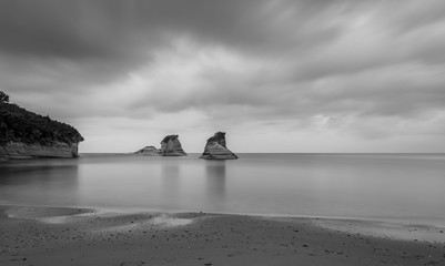 Cliff rocks in the sea long exposure in black and white