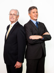 Portrait of smiling businessmen standing together
