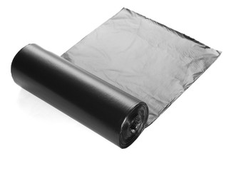 black roll of plastic garbage bags isolated on white