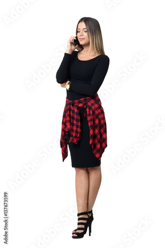 Graceful young feminine elegant woman in high heels talking