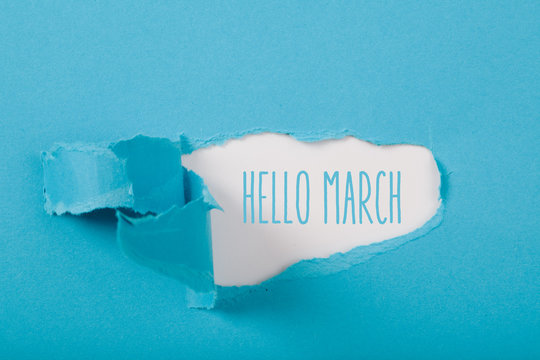 Hello March message on Paper torn ripped opening