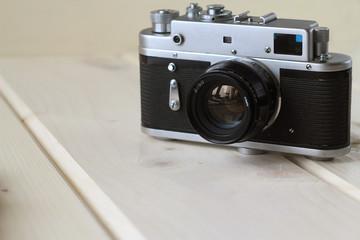 Film  retro camera on a wooden table, retro concept, light background