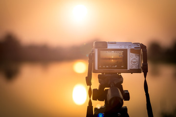 Set the camera on a tripod to record time-lapse video of the sunset.