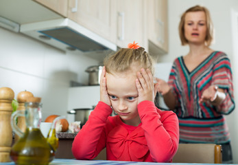 Frustrated woman scolding little girl