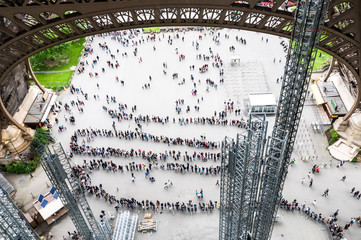 Line of people for entrance on the Eiffel Tower Paris, France