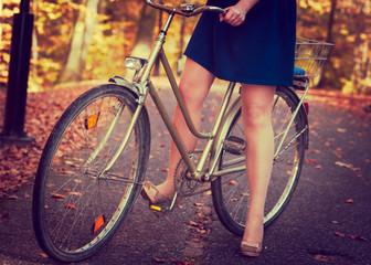 Lady in blue dress on the bike.