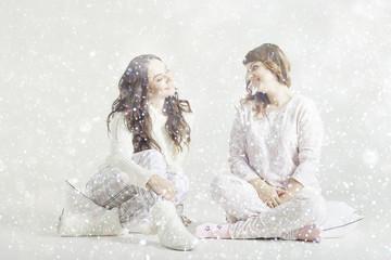 girl sitting in pajamas laughing Christmas Background