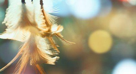 Dream catcher and bright light with blurred focus for background